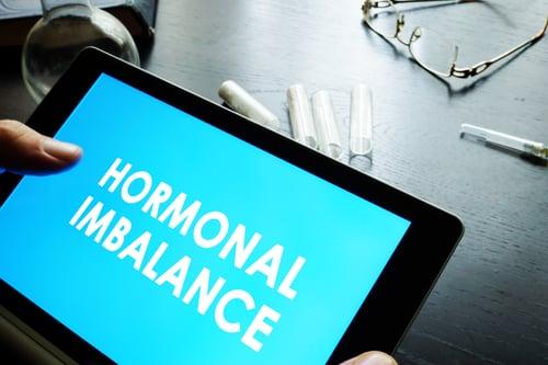 Ipad with hormonal imbalance on screen
