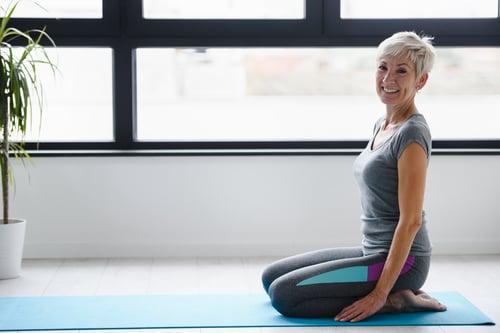 Portrait of smiling beautiful senior woman health instructor