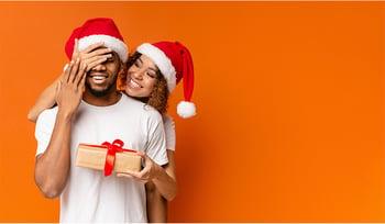 Girl giving boyfriend christmas gift