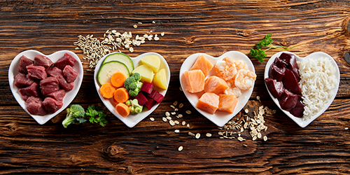 Healthy food in heart shaped dishes