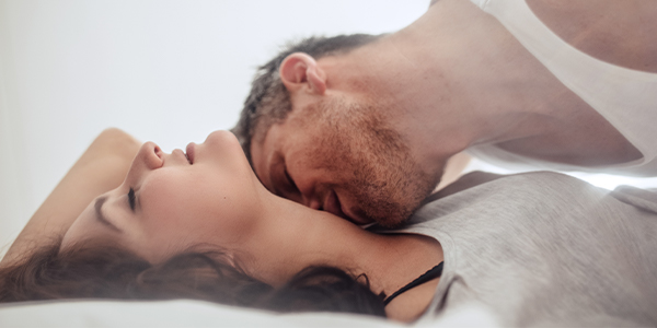 Man kissing a womans neck