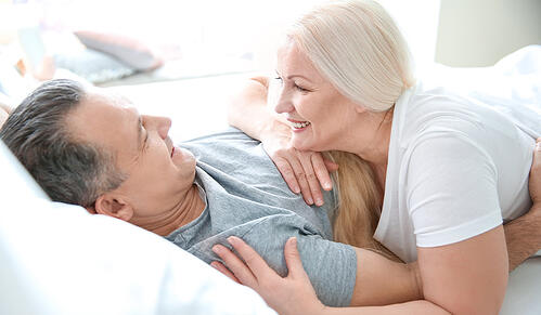 Senior couple in bed together at home_