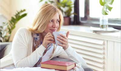 middle-aged-woman-drinking-coffee-content